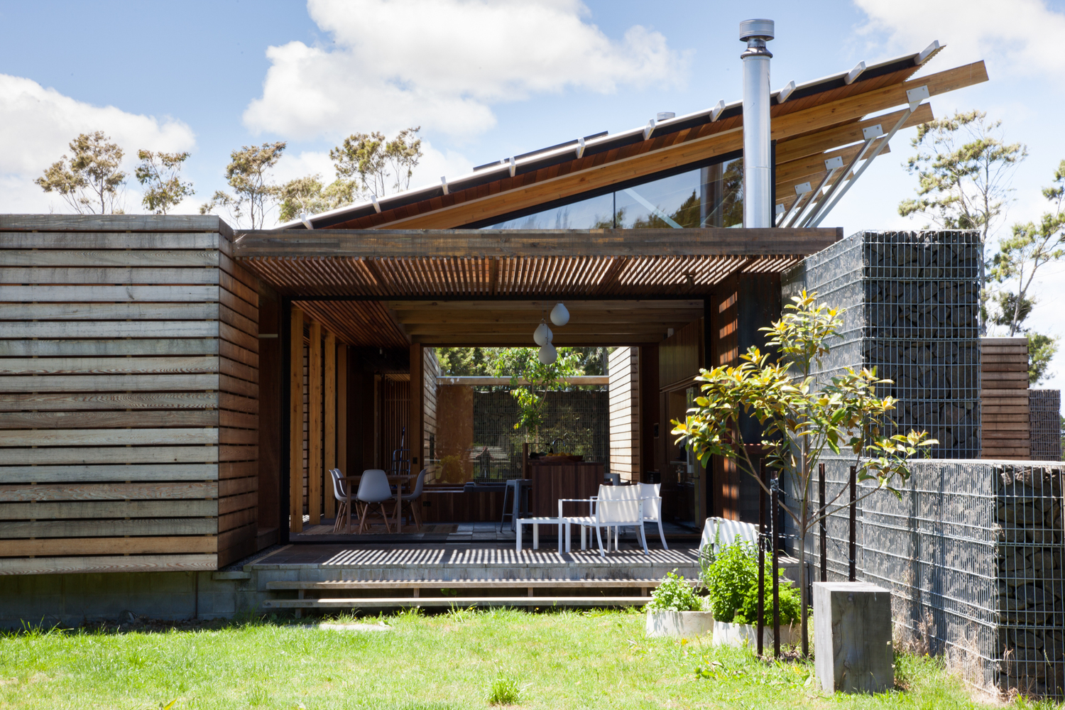 This Home Is Grounded Into Its Site by Walls of Gabion Baskets