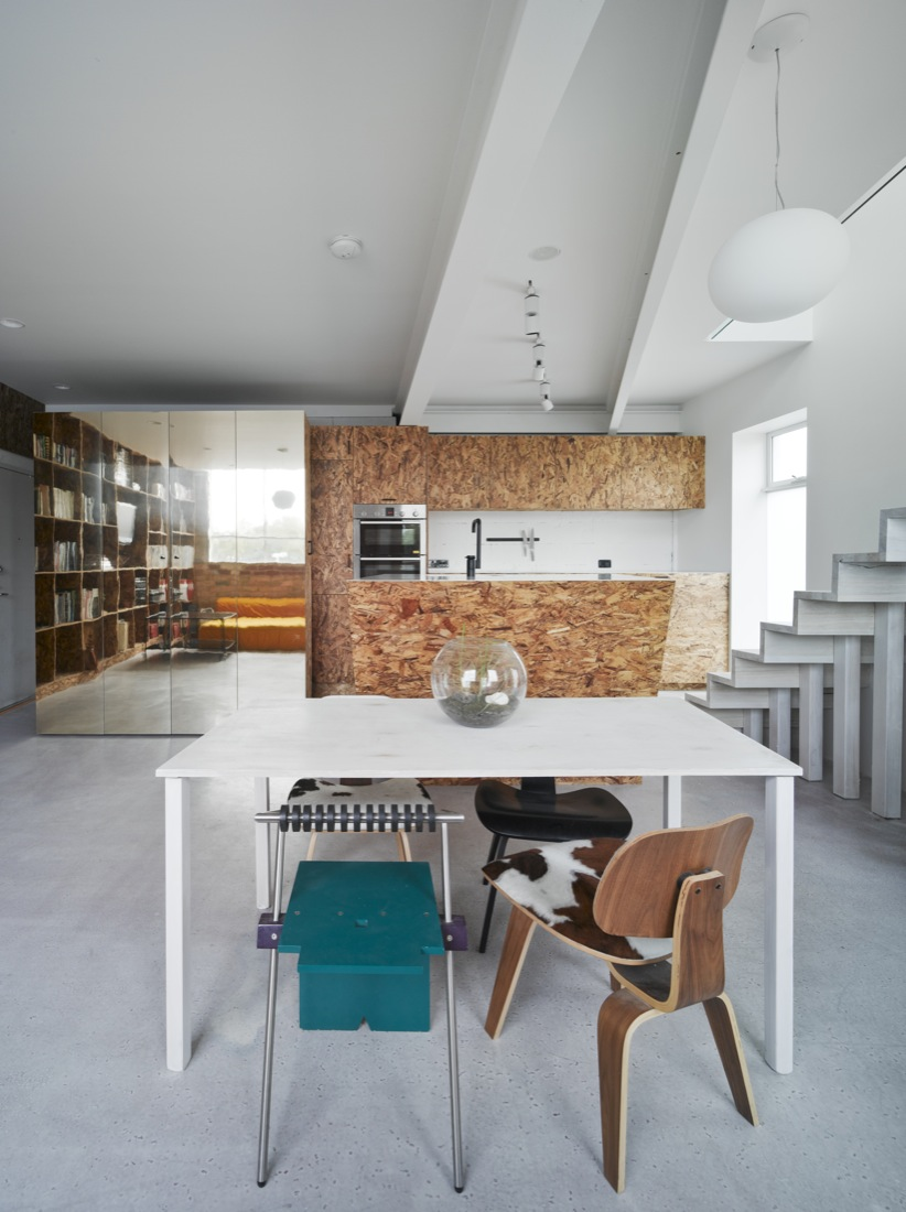 A simple palette of reflective gold, oriented strand board and white helps the Cubby House to feel light and bright