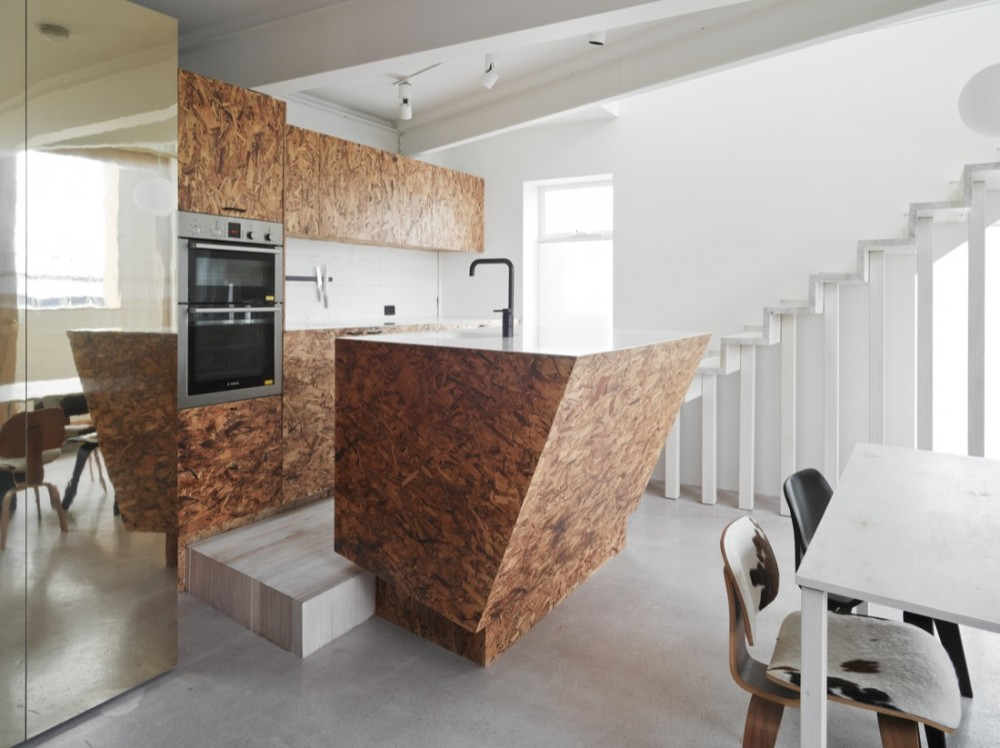 Reflective gold surfaces and furniture made from oriented strand board make Cubby House feel fun and playful