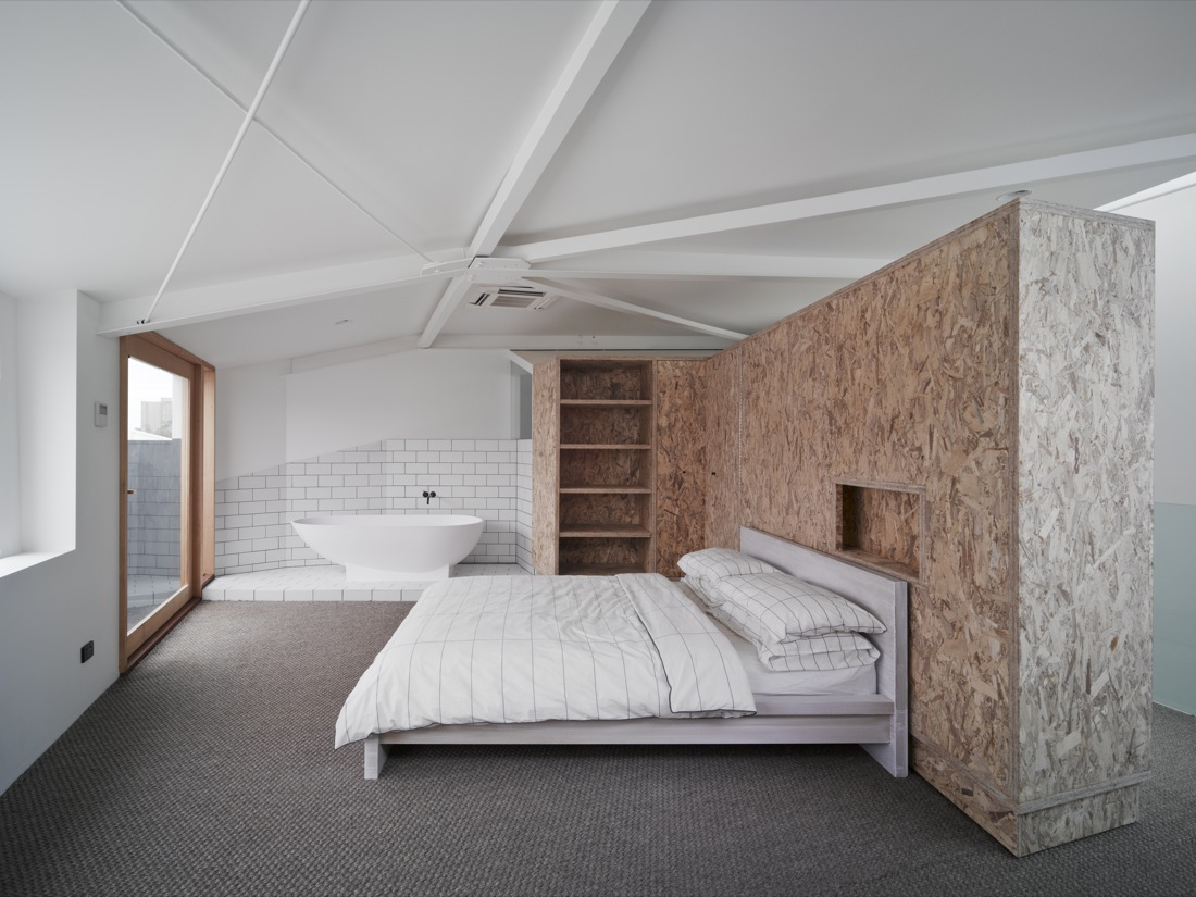 In the bedroom a large wardrobe can pivot out of the way to create a second bedroom or study area to make the most of Cubby House's small space