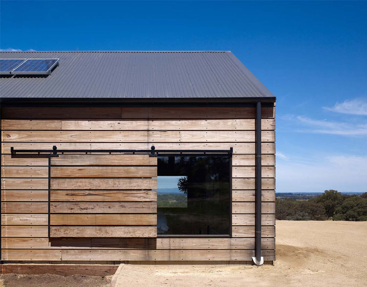Hill Plain House has sliding shutters that can be pulled across windows for shading or protection