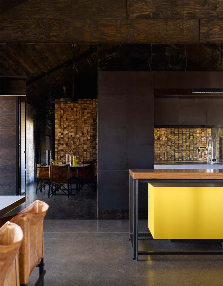 Inside Hill Plain House, the colors are dark, moody and richly detailed