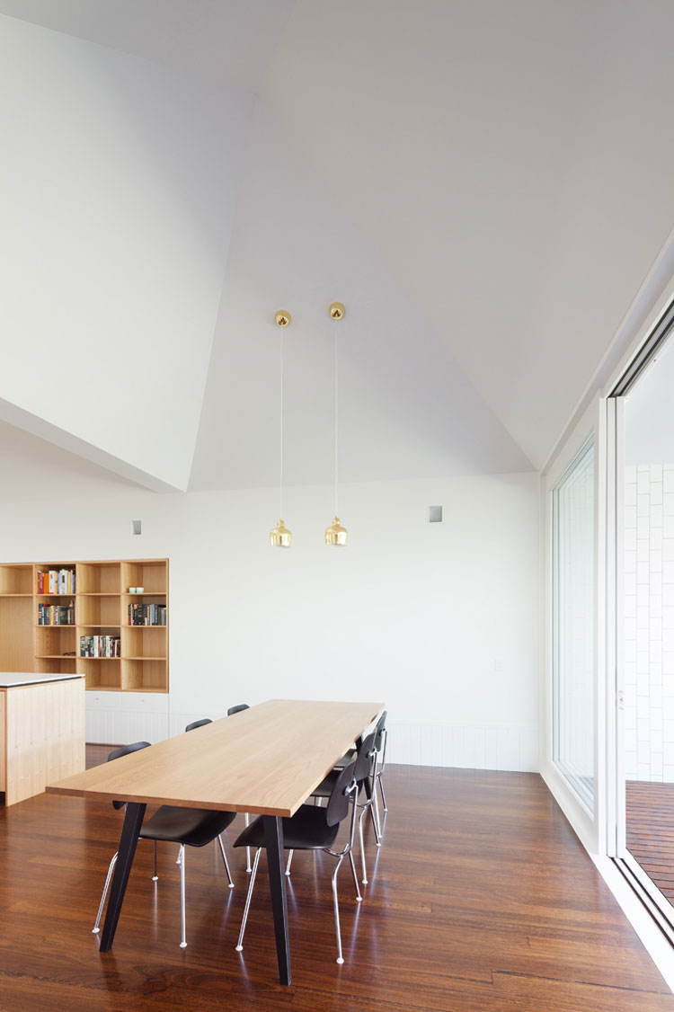 Timber floorboards and sculpted ceiling are the show stoppers in House Chapple's dining area