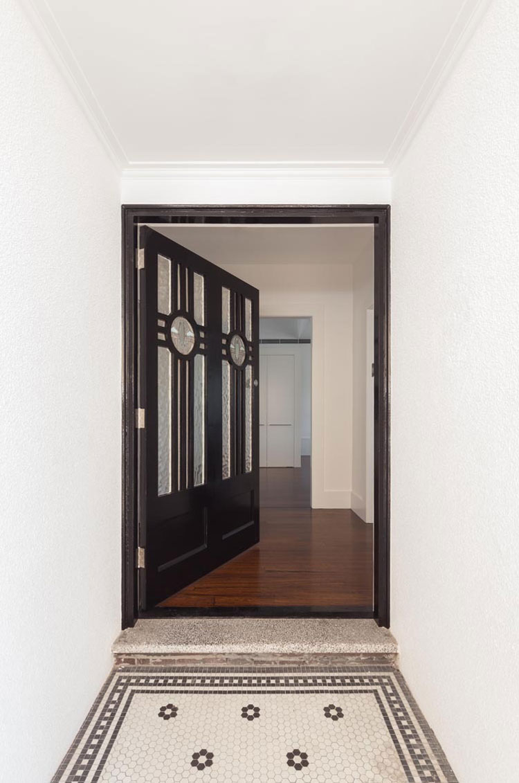 The original 1920s front of House Chapple has been maintained, including this gorgeous door and entry tiling