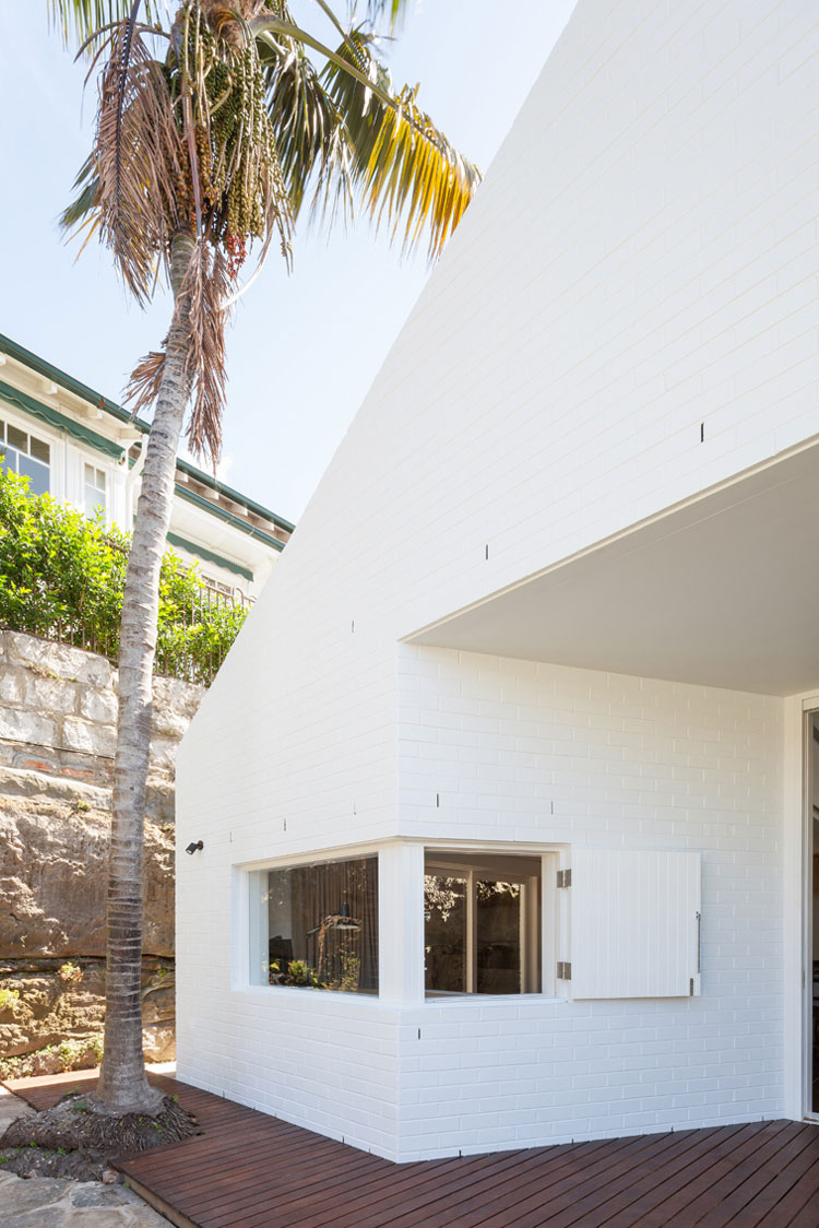 Outside House Chapple's painted white brick matches the original, while also creating a sense of retro glamor