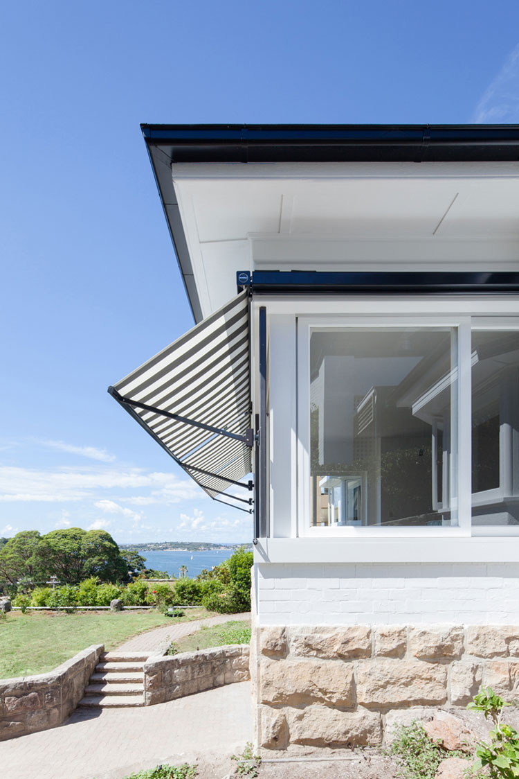 Fabric awnings on the windows of House Chapple hark back to the '60s -- an era the client wanted to celebrate
