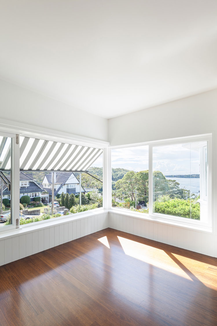 Sun pours into the house from the sun room which also has stunning views of Sydney Harbor