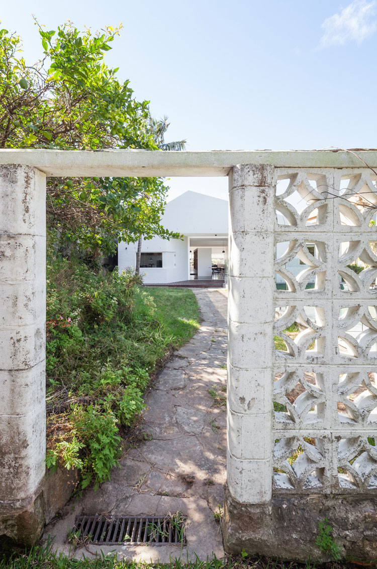 From the rear entry of House Chapple, the original concrete breeze block wall remains -- a reminder from the era when this family first moved in