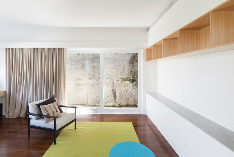 Built in storage, retro furniture and colors inspired by limestone in the area define the style of House Chapple