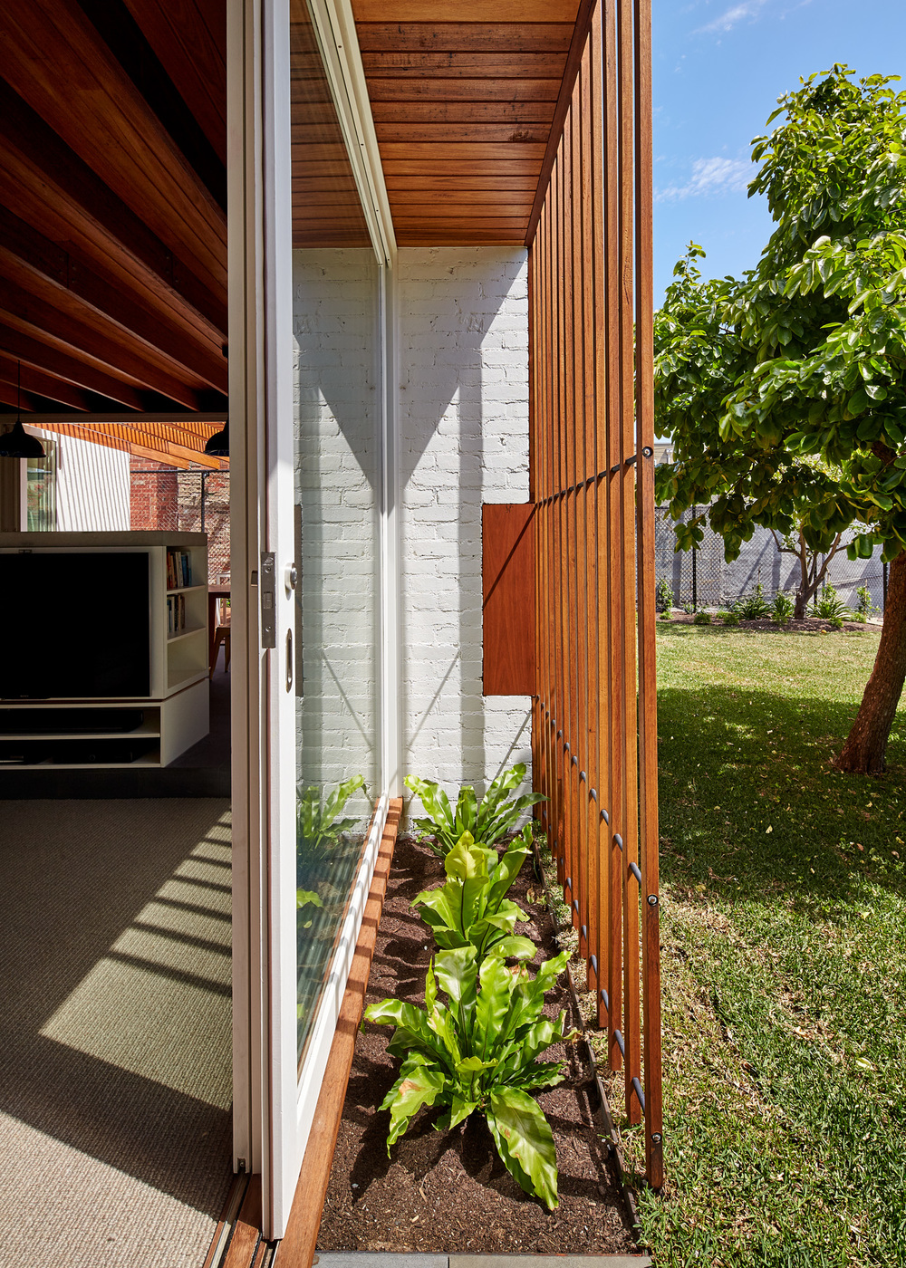 Rich Materials and Light-Filled Courtyards Connect Old to New