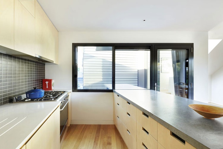 Yarra Street House with plywood kitchen and concrete bench-top (via Lunchbox Architect)